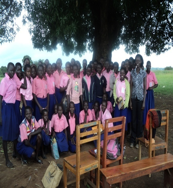 GWED-G staff, Oyella Juliet, together with the girls club in Pagak Primary school during support and mentoring visits to girls.
